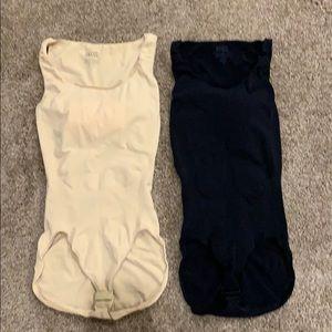 Two Spanx Undie-testable bodysuits.